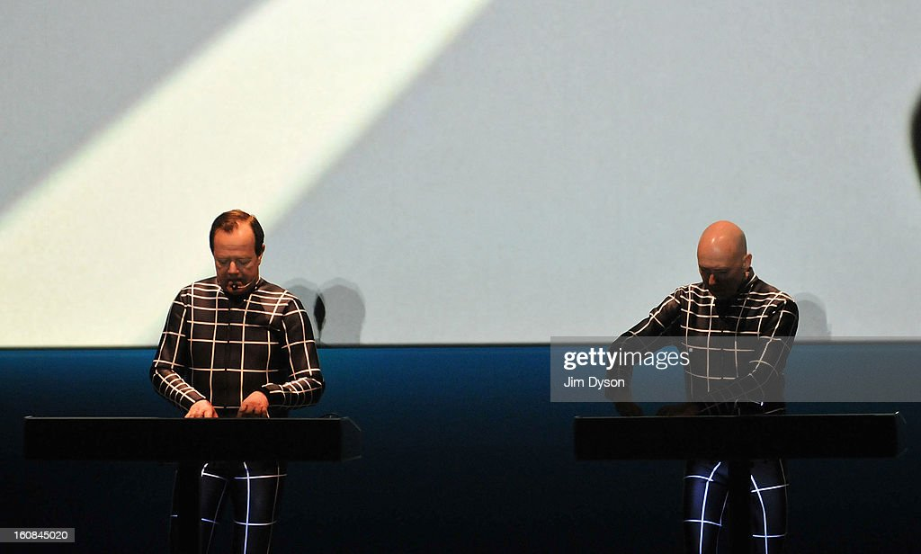 Ralf Hutter (L), and Henning Schmitz of German electronic pioneers Kraftwerk, perform live on stage during the first night of their Catalogue 12345678 retrospective at the Tate Modern Turbine Hall on February 6, 2013 in London, England.