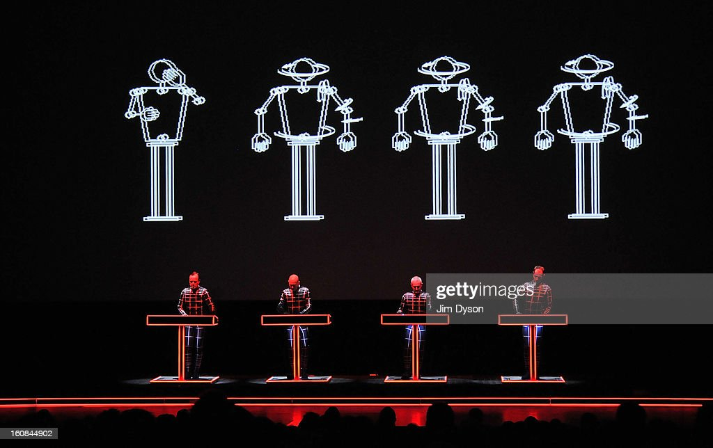 Ralf Hutter, Henning Schmitz, Fritz Hilpert and Falk Grieffenhagen, of German electronic pioneers Kraftwerk, perform live on stage during the first night of their Catalogue 12345678 retrospective at the Tate Modern Turbine Hall on February 6, 2013 in London, England.