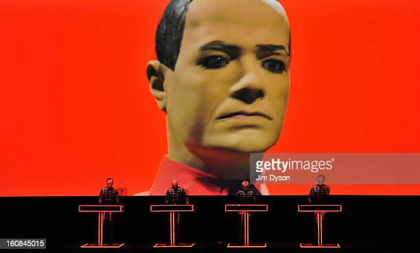 Ralf Hutter Henning Schmitz Fritz Hilpert and Falk Grieffenhagen of German electronic pioneers Kraftwerk perform live on stage during the first night...