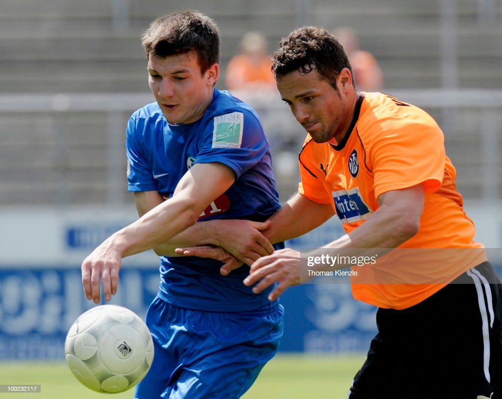 Ralf Kettemann of VfR Aalen and Jerome Gondorf of Stuttgarter Kickers challenge for the ball during the Regionalliga match between VfR Aalen and...