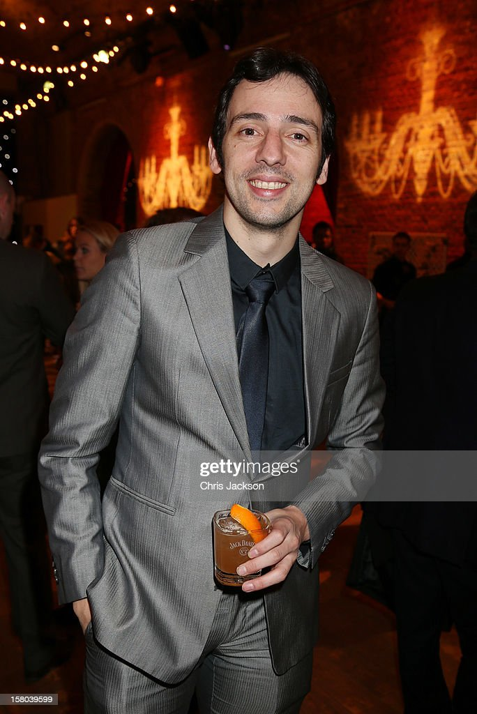 Ralf Little drinks a 'Curtain Raiser' cocktail at the post-show party, The 25th Hour, following The Old Vic's 24 Hour Musicals Celebrity Gala 2012 during which guests drank Jack Daniels Single Barrel, Curtain Raiser cocktails in The Great Halls, Vinopolis, Borough on December 9, 2012 in London, England.