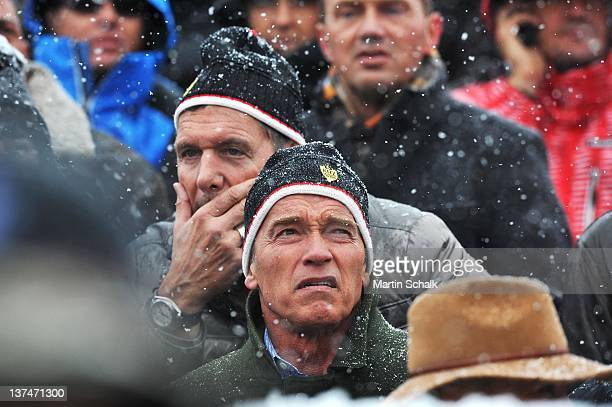 Ralf Moeller and Arnold Schwarzenegger attend the FIS Mens Downhill Worldcup race at the Streif race course on January 21 2012 in Kitzbuehel Austria