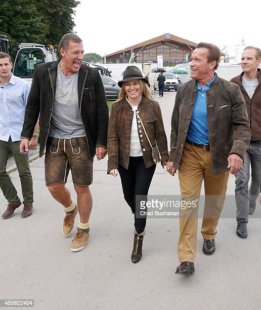 Ralf Moeller Heather Mulligan and Arnold Schwarzenegger leave the SchuetzenFestzelt during Oktoberfest at Theresienwiese on September 22 2014 in...