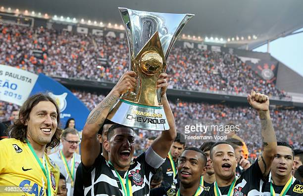 Ralf of Corinthians celebrates with the trophy after winning the match between Corinthians and Sao Paulo for the Brazilian Series A 2015 at Arena...