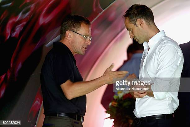 Ralf Ragnick Sports Director of Leipzig talks to Oliver Mintzlaff CEO of Leipzig prior to the Bundesliga match between RB Leipzig and Borussia...