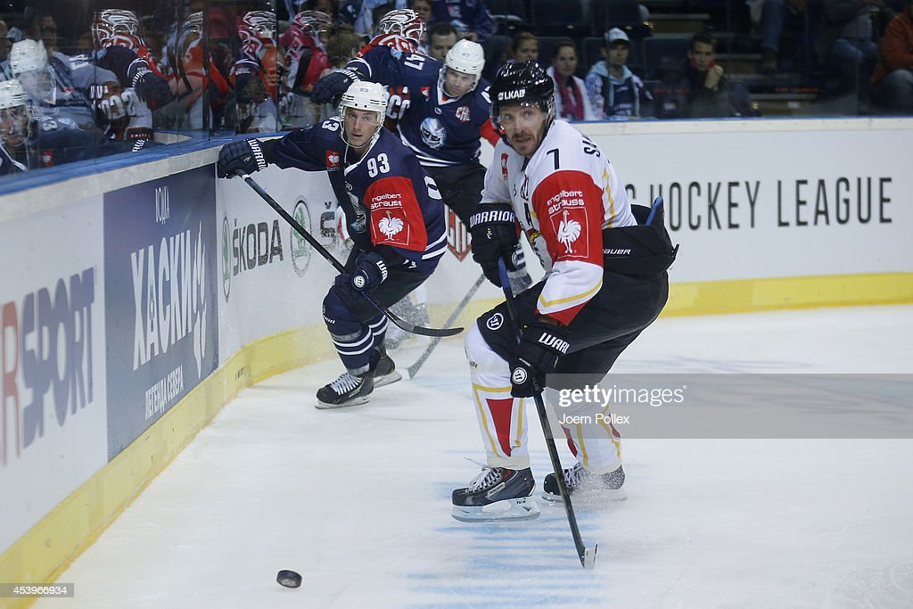 Ralf Rinke (L) of Hamburg and Jan Sandstrom of Lulea compete for the puck during the Champions Hockey League group stage game between Hamburg Freezers and Lulea Hockey on August 22, 2014 in Hamburg, Germany.