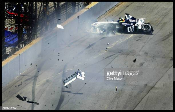 Ralf Schumacher of Germany and BMW Williams spins away from the wall after hitting the wall as he came around the last corner during the United...