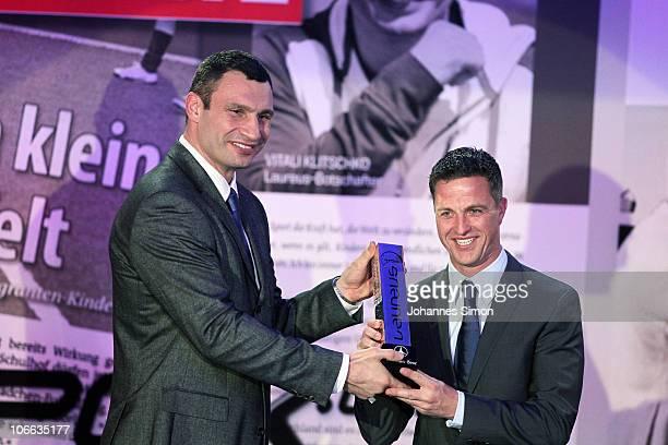 Ralf Schumacher receives the Laureus award from Vitali Klitschko during the Laureus Media Award 2010 at Grand Tirolia Golf Ski Resort on November 8...