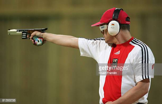 Ralf Schummann of Germany during the men's 25 metre rapid fire pistol finals on August 21 2004 during the Athens 2004 Summer Olympic Games at the...