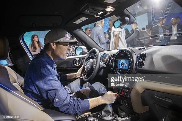 Rally car driver Bryce Menzies sits inside the Bayerische Motoren Werke AG MINI Countryman compact sports utility vehicle during its unveiling at an...