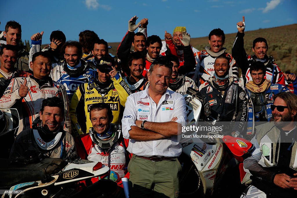 Rally director <a gi-track='captionPersonalityLinkClicked' href=/galleries/search?phrase=Etienne+Lavigne&family=editorial&specificpeople=643127 ng-click='$event.stopPropagation()'>Etienne Lavigne</a> poses with the motorbike and quadbike riders as they get ready to compete in stage 13, the final leg on the way to Illapel during Day 14 of the 2014 Dakar Rally on January 18, 2014 in La Serena, Chile.
