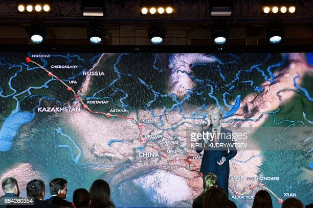 Rally Director Vladimir Chagin gives a speech during the presentation of the 2017 Silk Way Rally in Moscow on May 17 2017 The rally will start on...