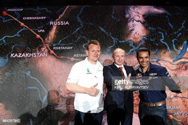 Rally Director Vladimir Chagin Petronas Iveco's Dutch driver Gerard De Rooy and Toyota's pilot Nasser AlAttiyah of Qatar attend the presentation of...
