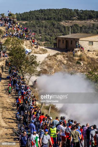 Rally fans cheer as a cloud of dust rises during the Terra Alta Stage of the Rally de Espana round of the 2017 FIA World Rally Championship on...