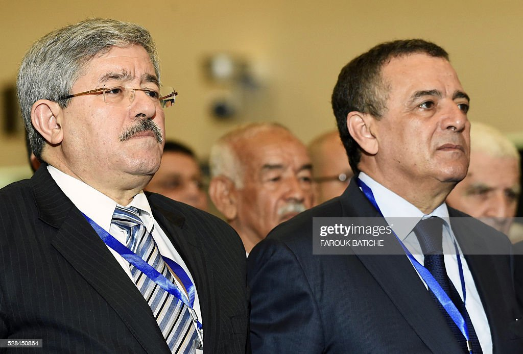 Rally for National Democracy (RND) party's interim secretary general, Ahmed Ouyahia (L), and Minister of Industry and Mining, Abdeslam Bouchouareb, attend an extraordinary meeting of the RND on May 5, 2016, in the Algerian capital Algiers. / AFP / Farouk Batiche