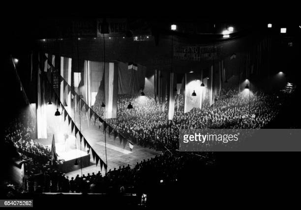 A rally in support of the Spanish Republicans takes place at the Vel d'Hiv cycling track in Paris on February 14 1937 French Communist Party leader...