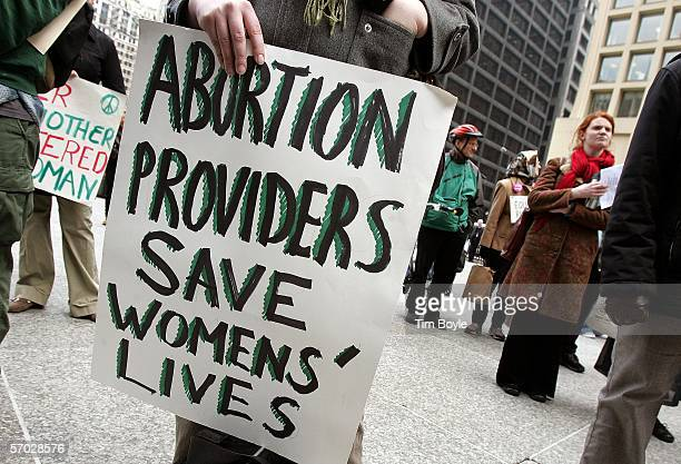 A rally participant's holds a sign that reads 'Abortion Providers Save Womens' Lives' during an International Women's Day march March 8 2006 in...