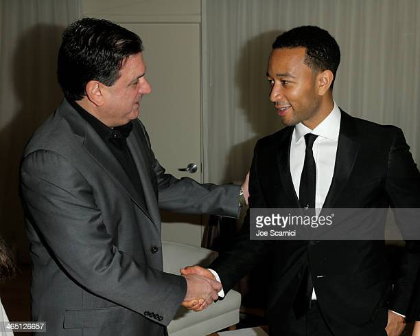 Ralph Andetta Head of Product Management Citi Cards and singer/songwriter John Legend attend the Nielsen PreGRAMMY Party at Mondrian Los Angeles on...
