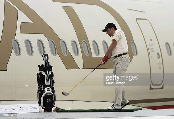 Ralph Bellet of Germany stands hits a ball on the wing of an Etihad Airways Airbus A340 during the 'Etihad Airways Swing on the Wing Challenge' on...