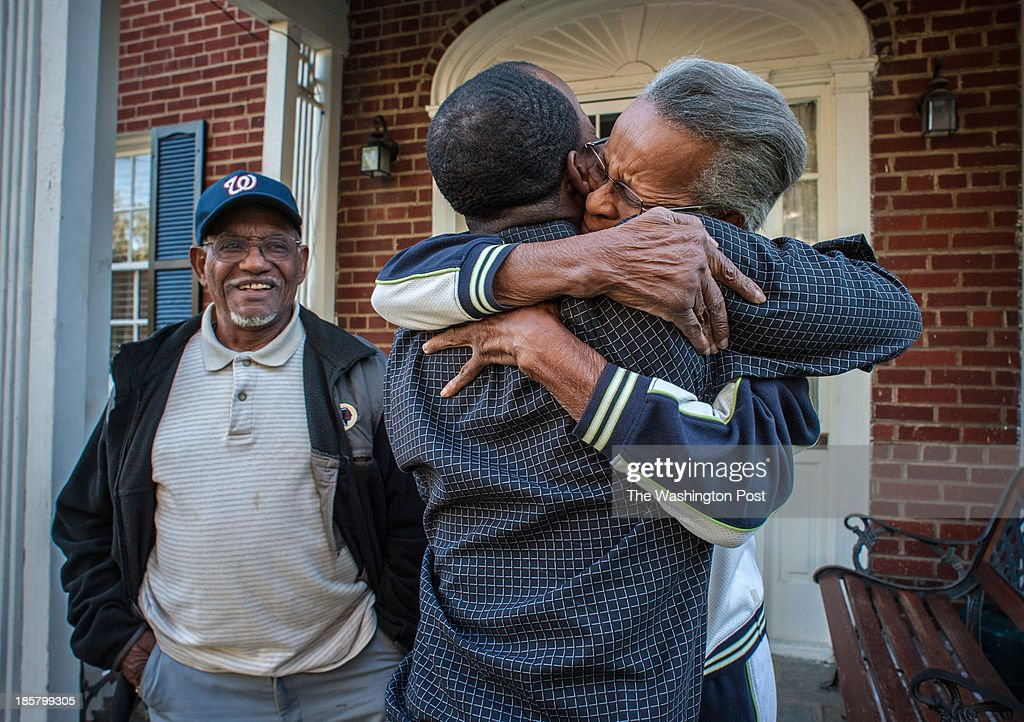 Ralph embraces his grandmother, Doris Chandler, 80, as his grandfather, Bobbie Chandler, 81, looks on. Ralph Lee, 31, co-owner of Acqua Al 2 on Capitol HIll and Ghibellina on 14th St., grew up in predominantly black HIllcrest in Southeast, but attended the exclusive Sidwell Friends school in Northwest. He's part of the young set of movers and shakers who are revitalizing the District.