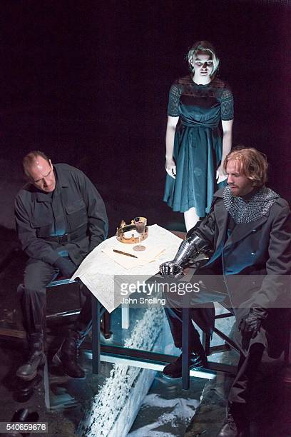Ralph Fiennes as Richard III Joanna Vanderham as Lady Anne and Tom Canton as Sir Robert Brakenbury perform on stage during a performance of Richard...