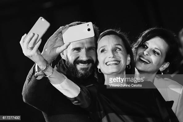 Ralph Fiennes Kristin Scott Thomas and Juliette Binoche tak a selfie on the red carpet for 'The English Patient Il Paziente Inglese' during the 11th...
