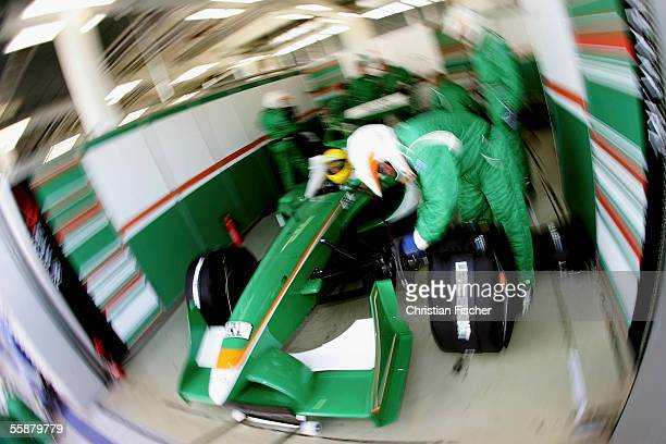 Ralph Firman of Team Ireland waits in the pit while mechanics work on his car during the third practice session at the A1 Grand Prix of Nations...