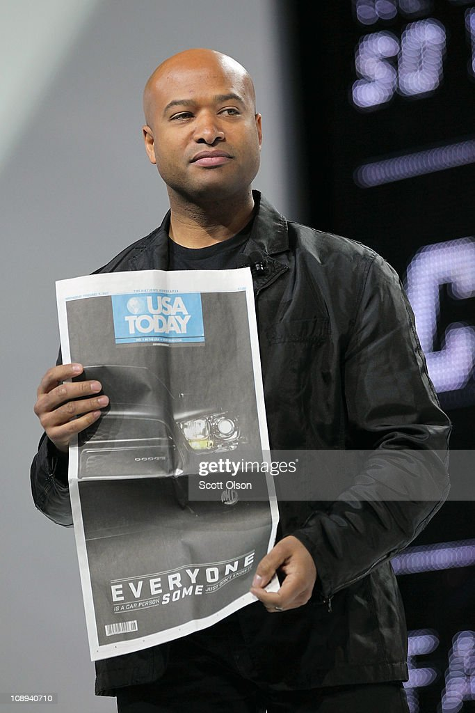 Ralph Gilles, President and CEO of Dodge Brand, shows off a copy of the USA Today newspaper featuring Dodge's new ad campaign at Chicago Auto Show on February 9, 2011 in Chicago, Illinois. The show opened for media previews today. It is open to the general public February 11.