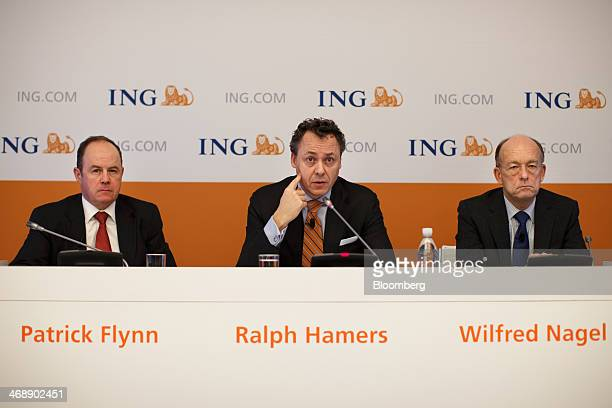 Ralph Hamers chief executive officer of ING Groep NV center speaks as Patrick Flynn chief financial officer of ING Groep NV left and Wilfred Nagel...