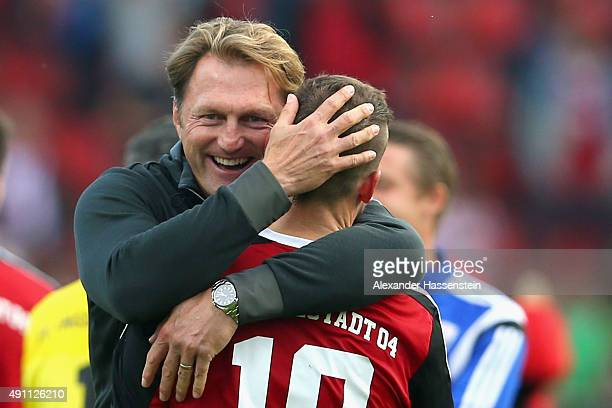 Ralph Hasenhuettl head coach of Ingolstadt celebrates victory with his player Pascal Gross after winning the Bundesliga match between FC Ingolstadt...