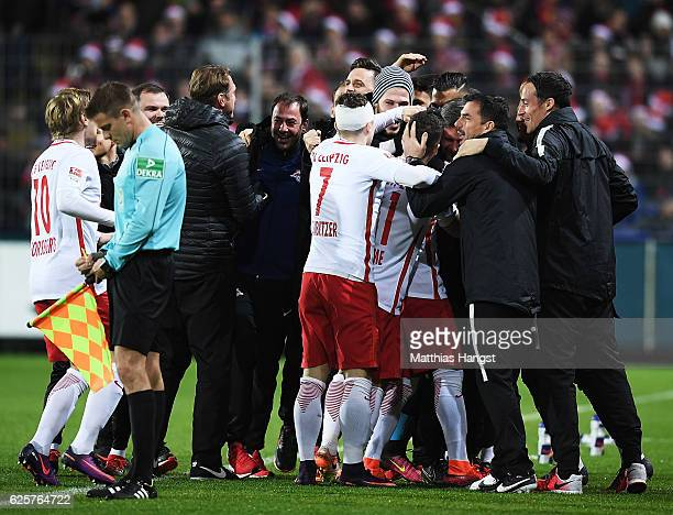 Ralph Hasenhuettl head coach of RB Leipzig and team mates congratulates Naby Deco Keita of RB Leipzig after he scored the first goal during the...