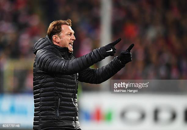 Ralph Hasenhuettl head coach of RB Leipzig celebrates his teams fourth goal by Marcel Sabitzer of RB Leipzig during the Bundesliga match between SC...