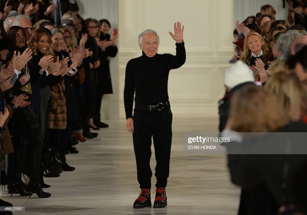 Ralph Lauren acknoledges the applause on the runway at the end of his show during the Mercedes-Benz Fashion Week Fall/Winter 2014 shows February 13, 2014 in New York. AFP PHOTO/Stan HONDA