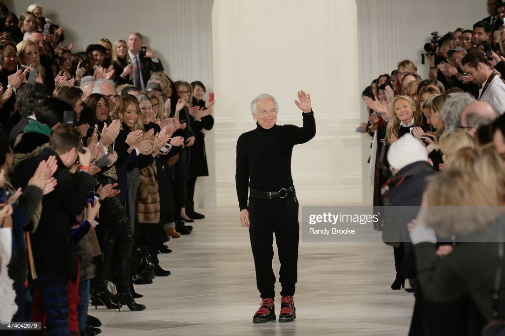 <a gi-track='captionPersonalityLinkClicked' href=/galleries/search?phrase=Ralph+Lauren+-+Fashion+Designer&family=editorial&specificpeople=4442108 ng-click='$event.stopPropagation()'>Ralph Lauren</a> greets the audience at the end of the show at <a gi-track='captionPersonalityLinkClicked' href=/galleries/search?phrase=Ralph+Lauren+-+Fashion+Designer&family=editorial&specificpeople=4442108 ng-click='$event.stopPropagation()'>Ralph Lauren</a> during Mercedes-Benz Fashion Week Fall 2014 at St. John's Center Studios on February 13, 2014 in New York City.