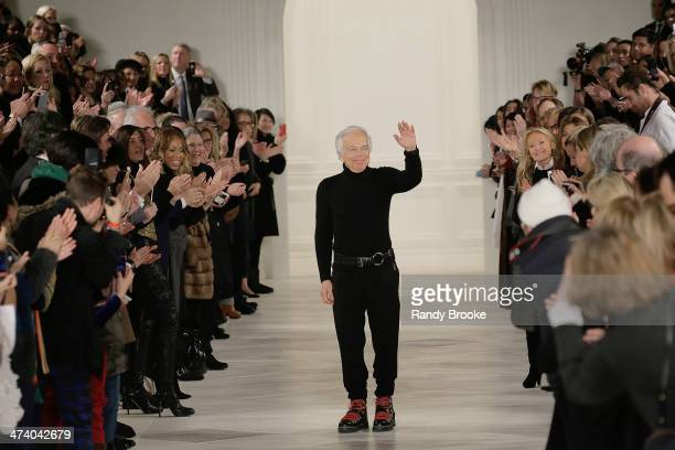 Ralph Lauren greets the audience at the end of the show at Ralph Lauren during MercedesBenz Fashion Week Fall 2014 at St John's Center Studios on...