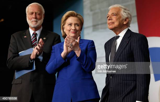 Ralph Lauren reacts after being awarded the James Smithson Bicentennial Medal by Hillary Clinton and Smithsonian Secretary Wayne Clough at the...
