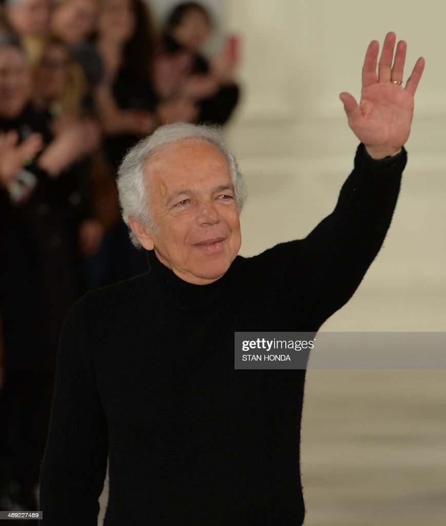 Ralph Lauren waves on the runway at the end of his show during the Mercedes-Benz Fashion Week Fall/Winter 2014 shows February 13, 2014 in New York. AFP PHOTO/Stan HONDA