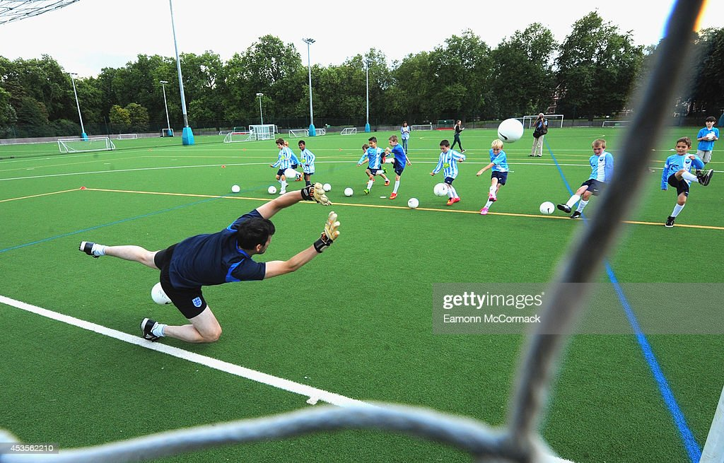 Ralph Little Star of 'The Unbeatables' attends a football training session on August 13 2014 in London England