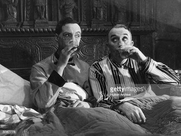 Ralph Lynn the British comedy actor on the left and Tom Walls the British actor and director are the two heroes of 'Thark Turkey Time' directed by...