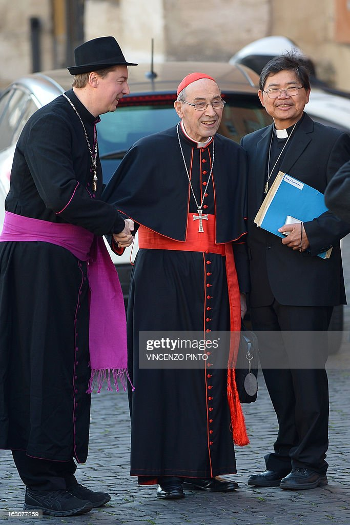 Ralph Napierski (L), a fake bishop poses with cardinal Sergio Sebiastiana as the cardinal arrives for talks ahead of a conclave to elect a new pope on March 4, 2013 at the Vatican. The Vatican meetings will set the date for the start of the conclave this month and help identify candidates among the cardinals to be the next leader of the world's 1.2 billion Catholics.