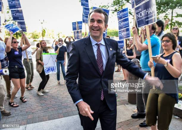 Ralph Northam greets supporters in front of the venue as progressive and labor groups from across the Commonwealth host a forum for him and fellow...