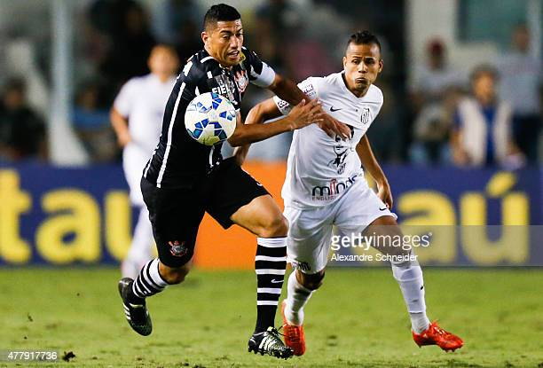 Ralph of Corinthians and Geovanio of Santos in action during the match between Santos and Corinthians for the Brazilian Series A 2015 at Vila Belmiro...