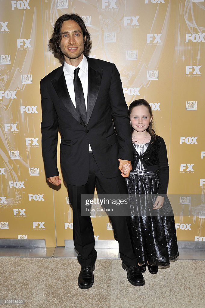Ralph Palchek and Izzy arrives for the Fox Broadcasting Company, Twentieth Century Fox Television And FX 2011 Emmy after party on September 18, 2011 in West Hollywood, California.