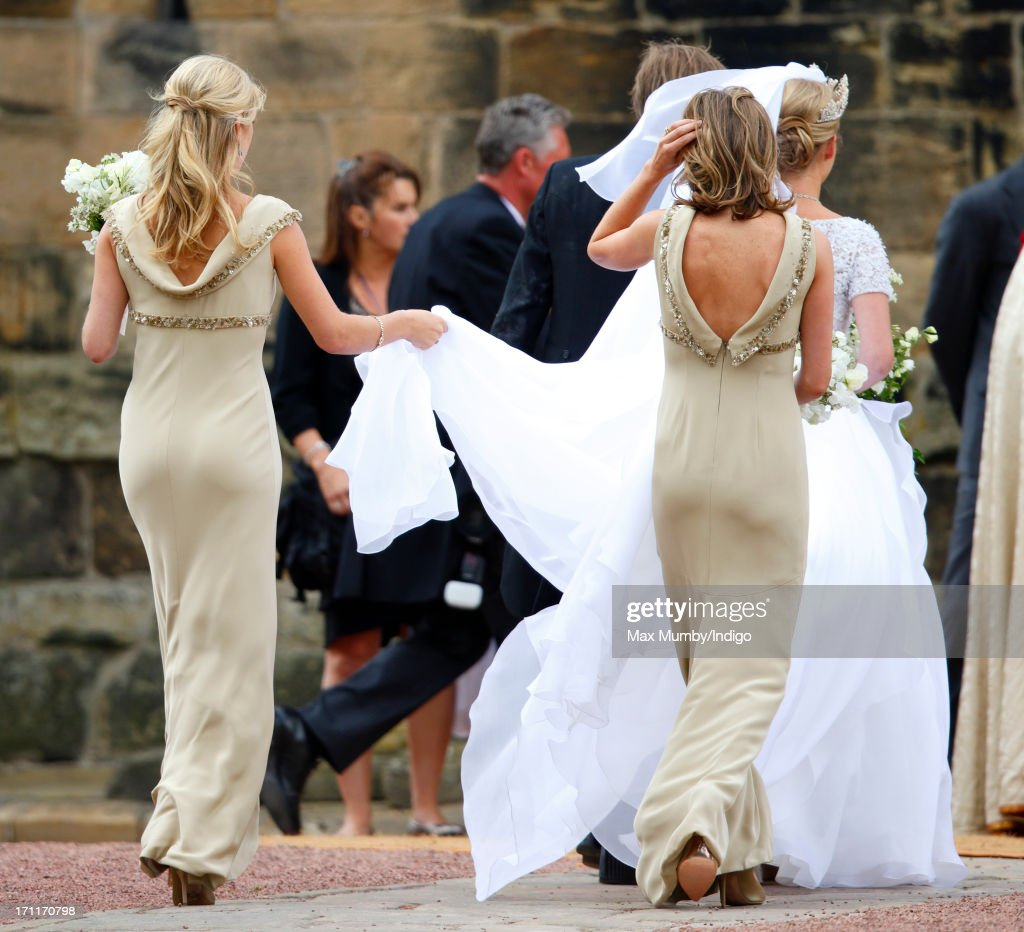 Ralph Percy, Duke of Northumberland escorts daughter Lady Melissa Percy accompanied by her bridesmaids Chelsy Davy (L) and Lady Catherine Valentine to St Michael's Church for her wedding on June 22, 2013 in Alnwick, England.