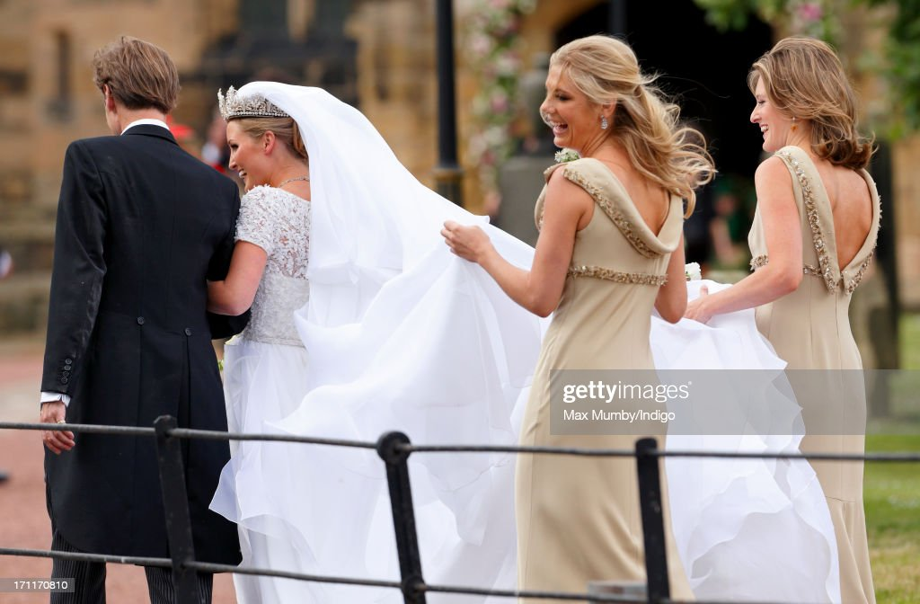 Ralph Percy, Duke of Northumberland escorts daughter Lady Melissa Percy accompanied by her bridesmaids <a gi-track='captionPersonalityLinkClicked' href=/galleries/search?phrase=Chelsy+Davy&family=editorial&specificpeople=740229 ng-click='$event.stopPropagation()'>Chelsy Davy</a> (L) and Lady Catherine Valentine to St Michael's Church for her wedding on June 22, 2013 in Alnwick, England.