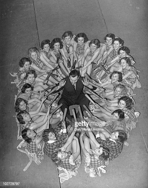 Ralph Reader the producer 1938 Ralph Reader the producer with some of the children appearing in his pantomime Drury Lane Theatre London 9 December...