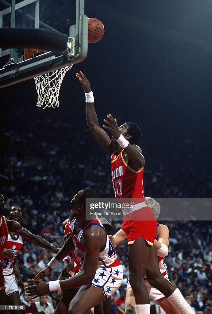 Ralph Sampson of the Houston Rockets shoots over Rick Mahorn of the Washington Bullets during an NBA basketball game circa 1984 at the Capital Centre...