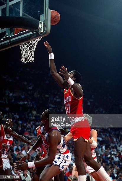 Ralph Sampson of the Houston Rockets shoots over Rick Mahorn of the Washington Bullets during an NBA basketball game circa 1984 at the Capital Centre...