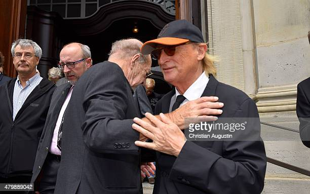 Ralph Siegel and Otto Waalkes attend the funeral service for the deceased composer and big band leader James Last at St Michaelis Kirche on July 8...