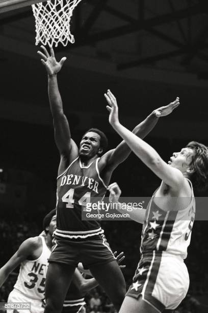 Ralph Simpson of the Denver Rockets/Denver Nuggets goes up for a rebound against Billy Paultz of the New York Nets during an American Basketball...